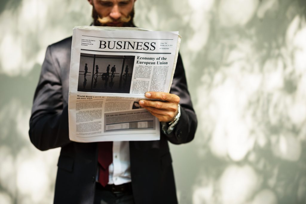 man holding business paper