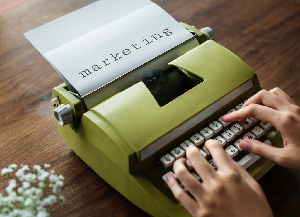 Retro type writer writing about marketing.