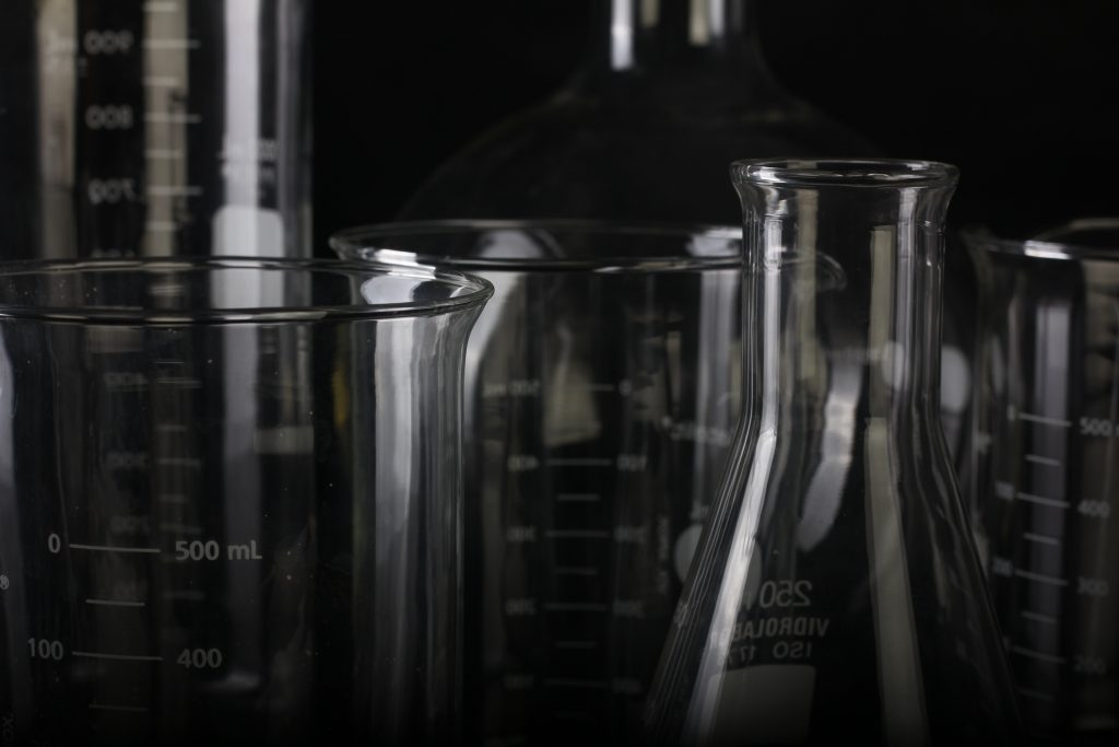 Beakers in a lab black and white