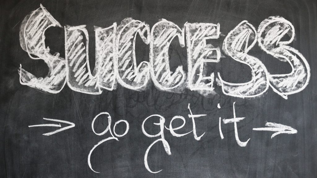 Success go get it, written on a blackboard.