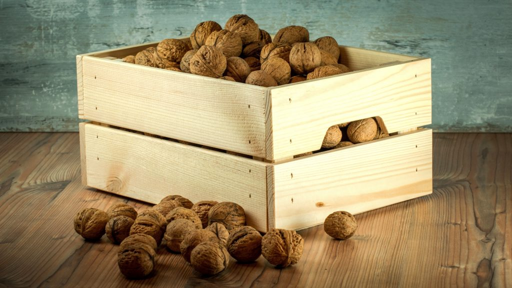 box of walnuts and some out of the box.